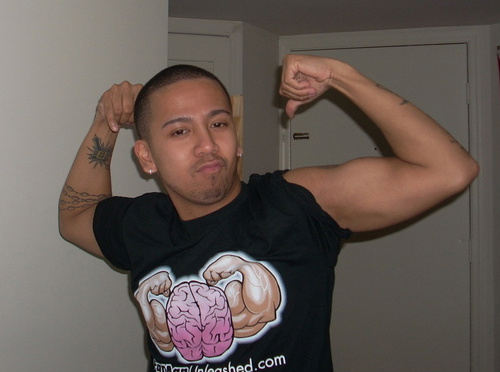 Ian Fernando Flexing with his Fat Man Unleashed T Shirt